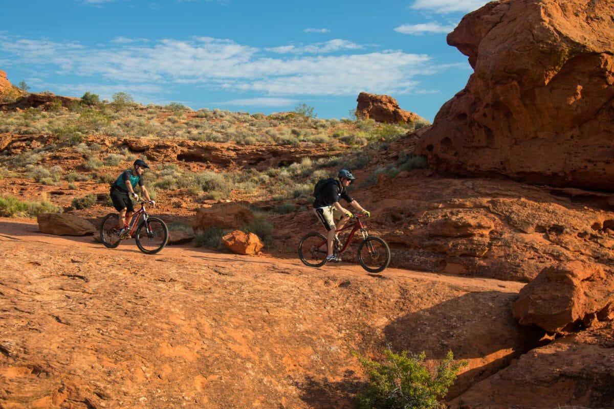 Mountain biking through red rocks.