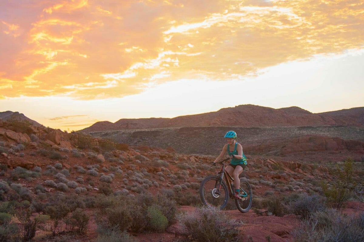 Female mountain biker at sunset.