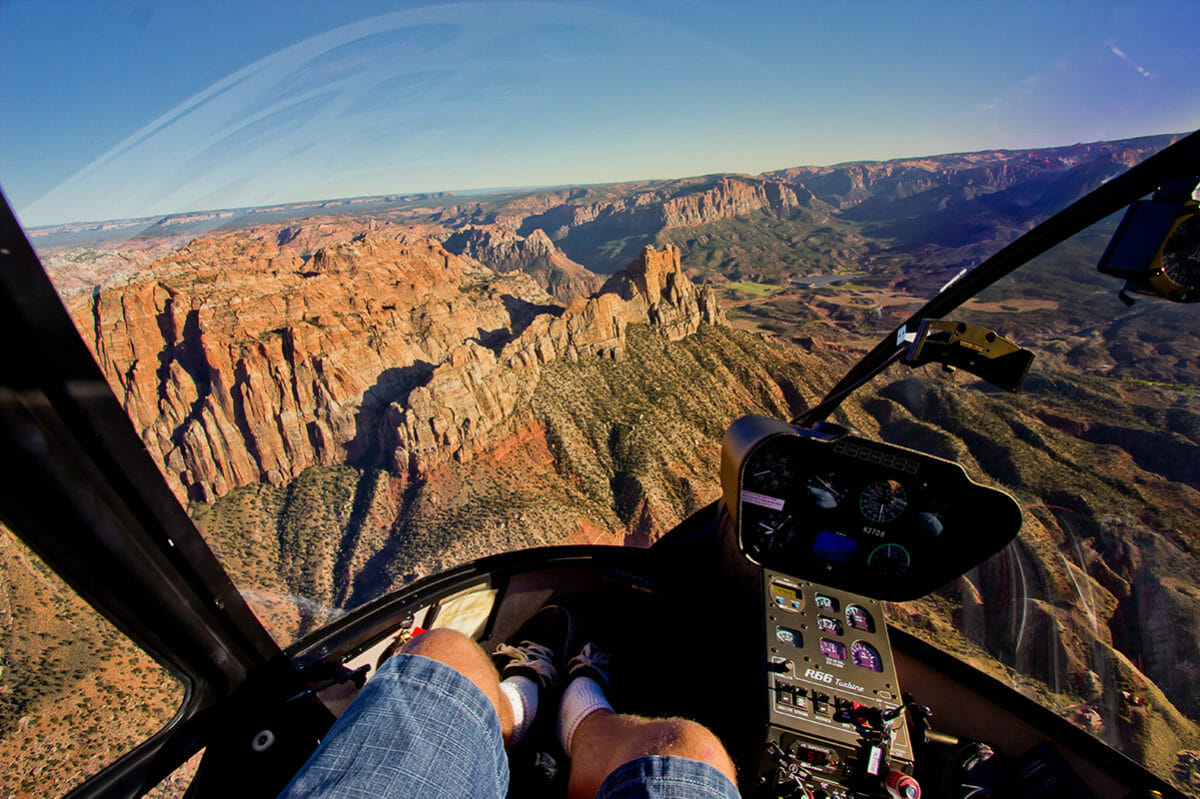 View from inside a helicopter of the rugged, rocky terrain.