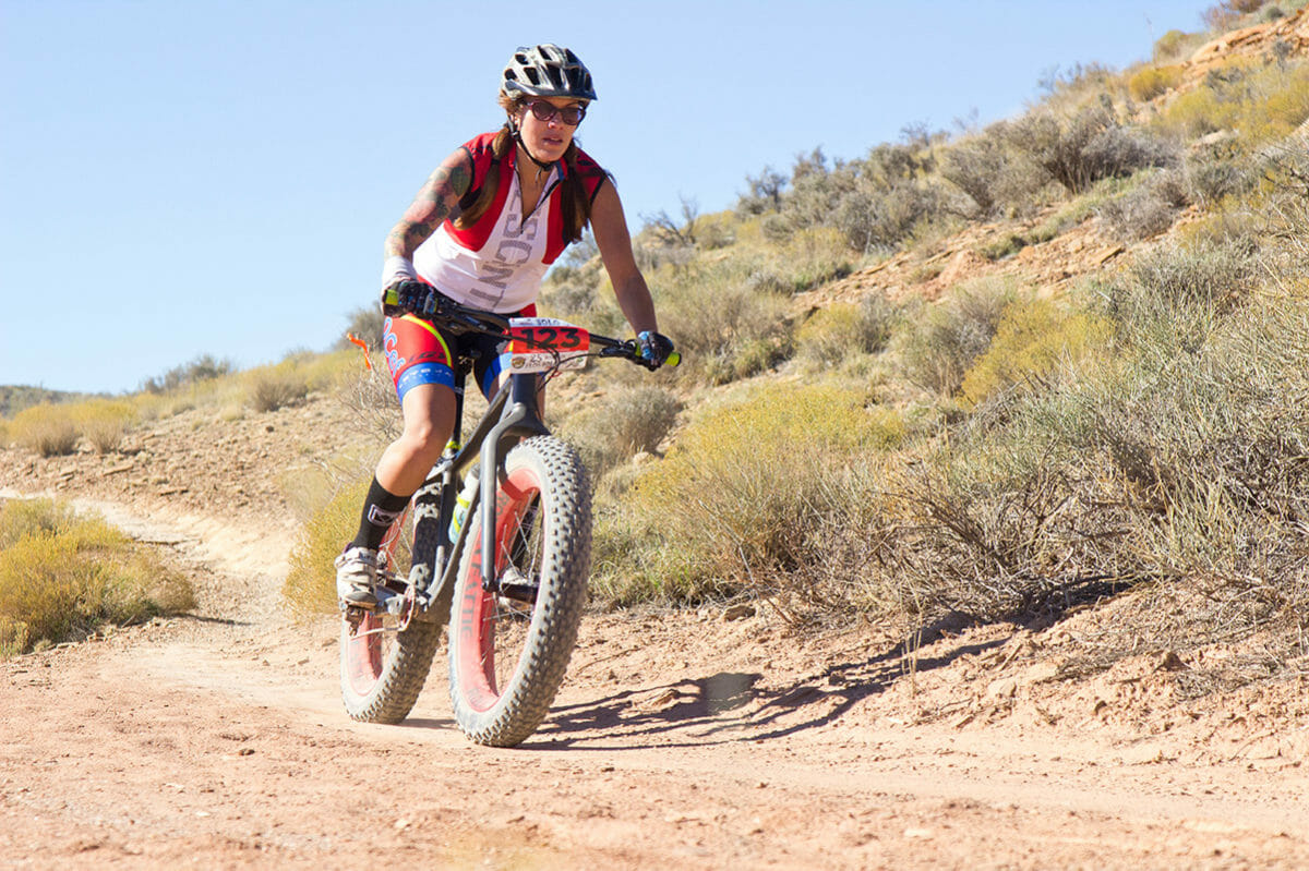 Woman on mountain bike with fat tires.