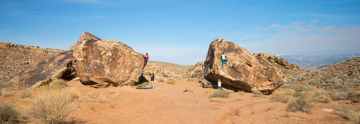 Group of climbers on two enormous twin boulders.