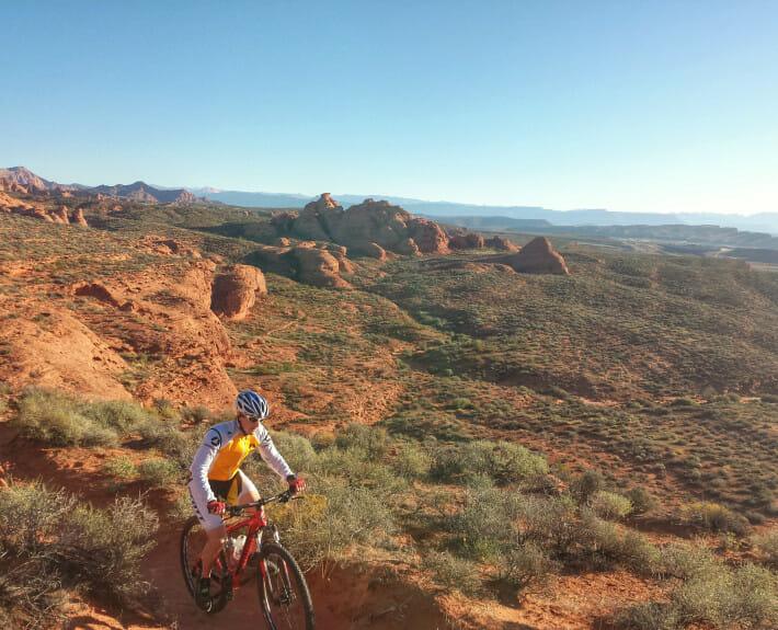Mountain biker on desert trail.