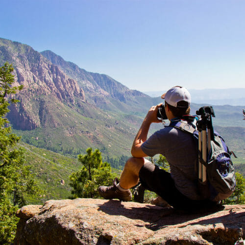 Man taking photos of far off mountain range