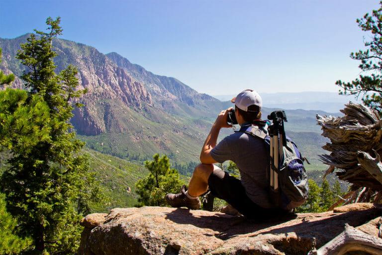 Man taking photos of far off mountain range
