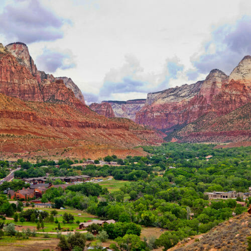 Panoramic view of the town of Springdale below the peaks of Zion National Park