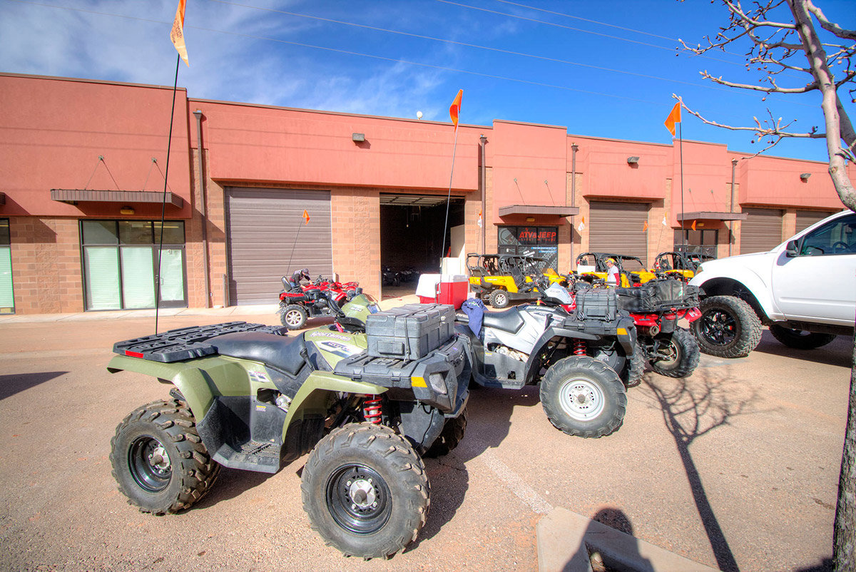 Group of ATVs parked outside storefront