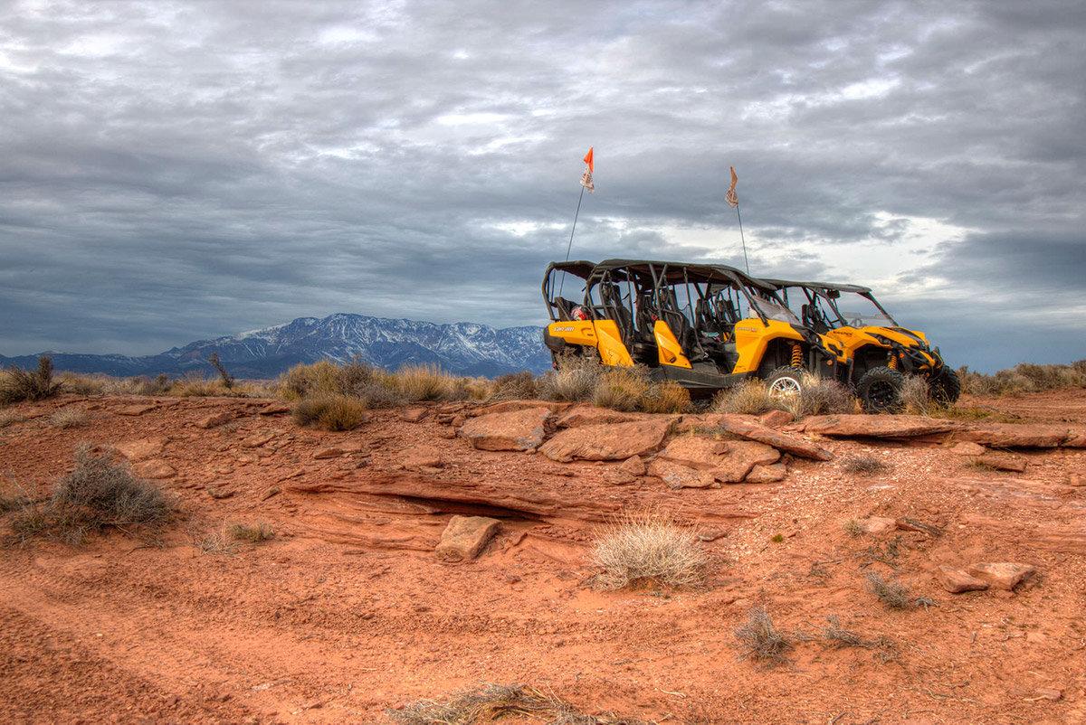 Two yellow Razor OHVs parked on rocky ground