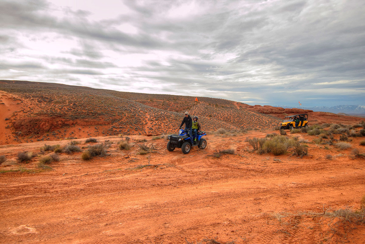 Man on ATV being followed by an OHV