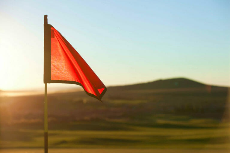Red golf tee flag