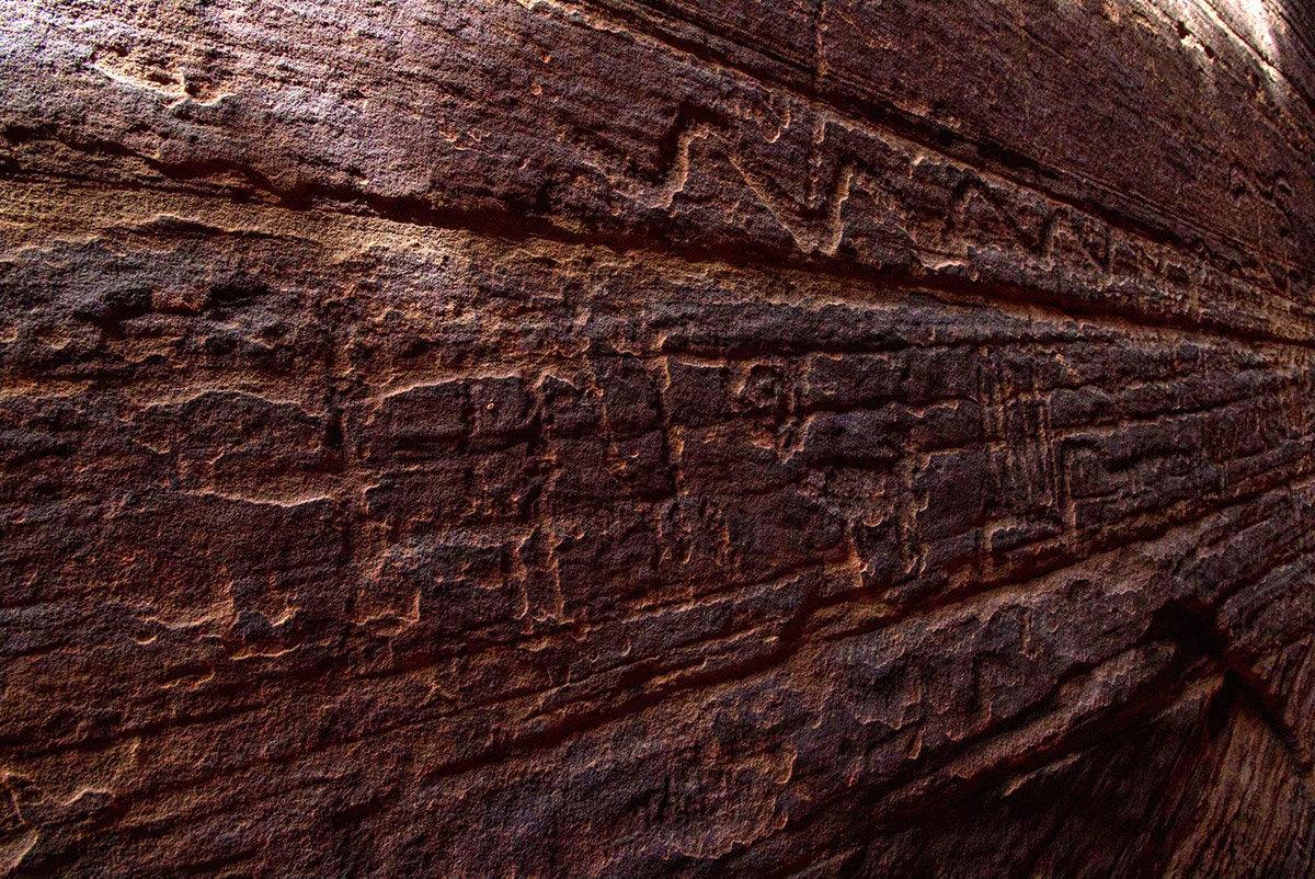 Close up view of petroglyphs on slot canyon wall