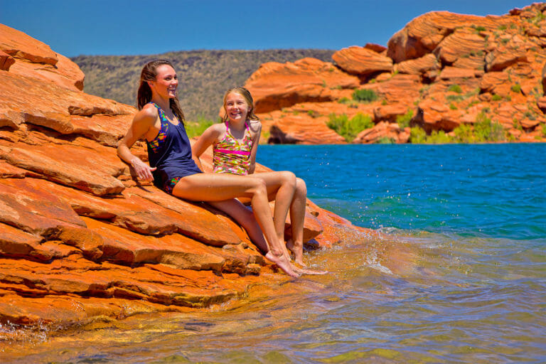Two girls sun bathing at Sand Hollow