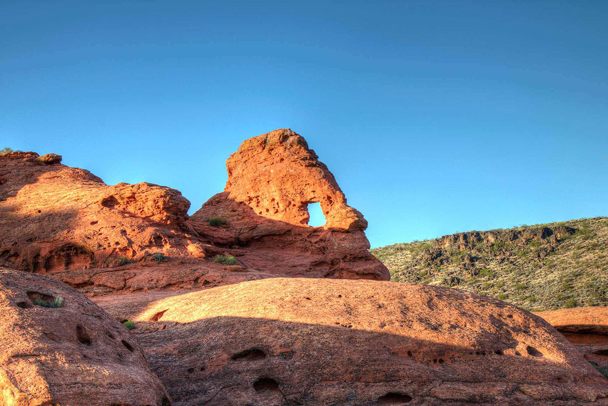 Red rock arch with blue sky