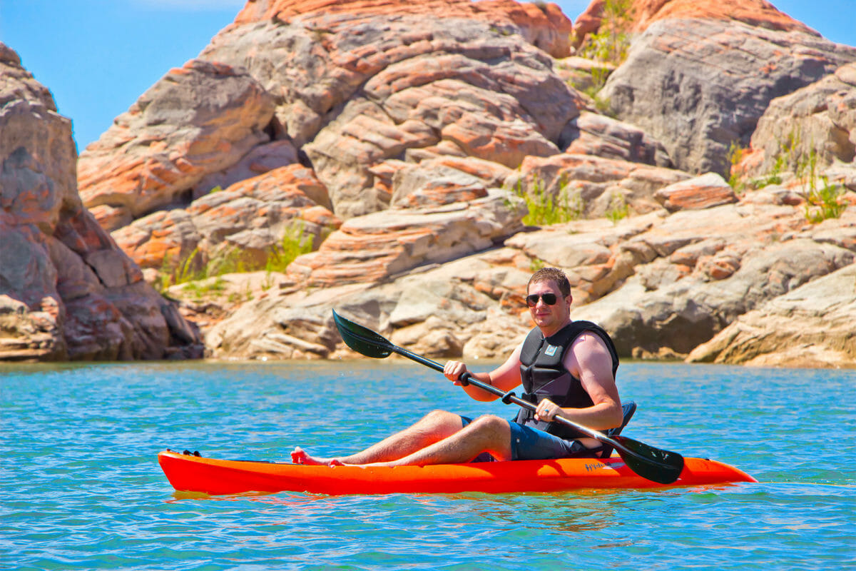 Man kayaking at Gunlock State Park