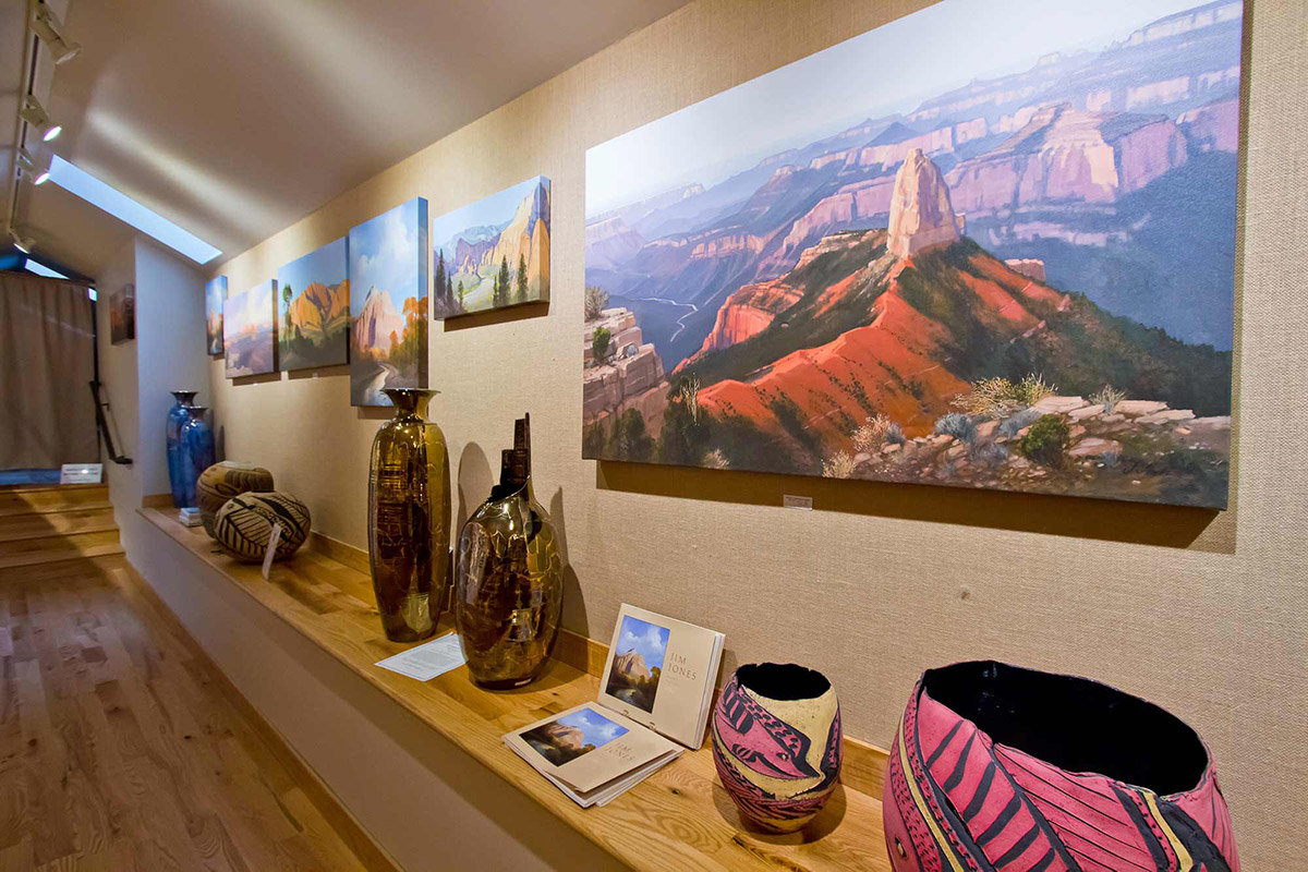 Paintings and southwestern vases on display
