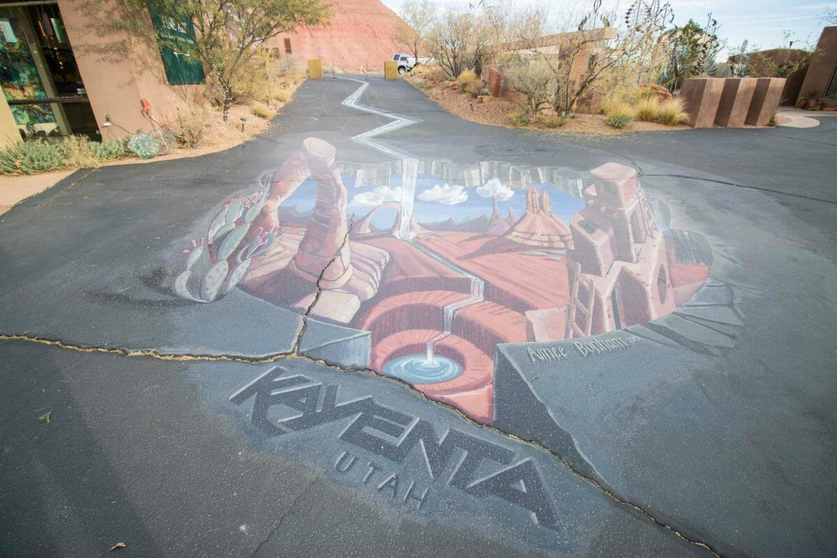 3-dimensional chalk art on desert road.