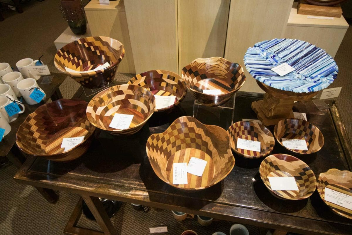 Wooden bowls on display table.
