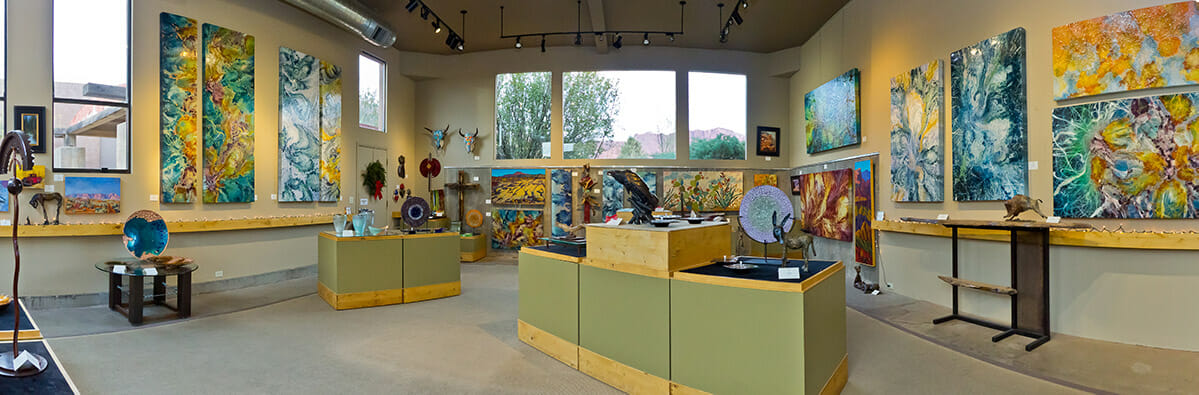 Panoramic view of the interior of an art gallery.