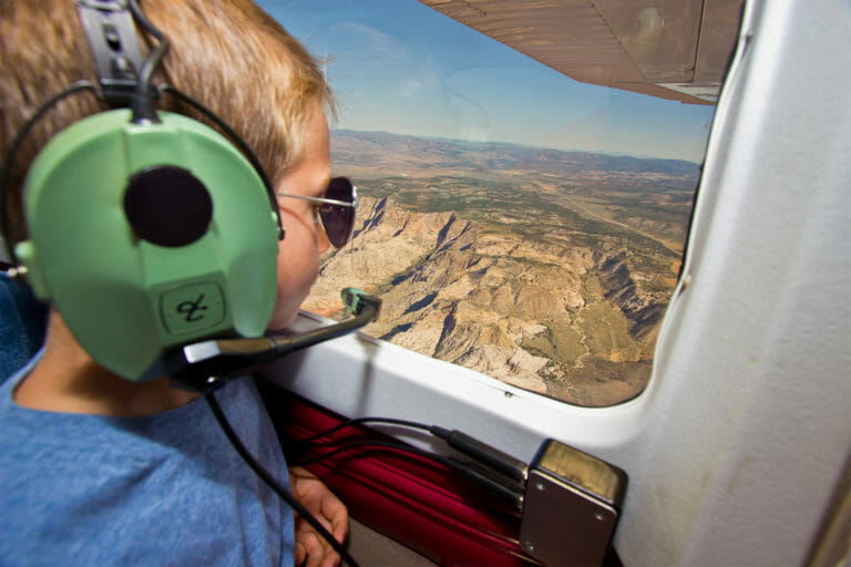 Boy looking out from plane window