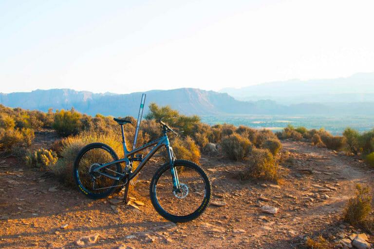Mountain Bike leaning on a trail marker