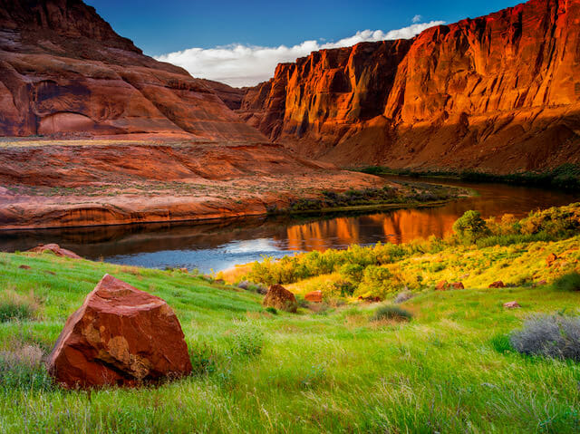 Reflection of Red Mountains in water. Photo Credit: Nathan Wotkyns