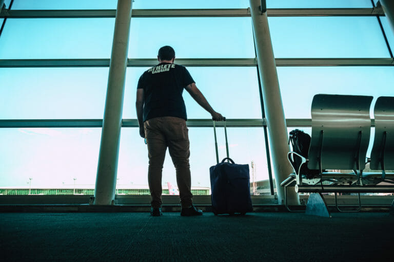 Man in airport with luggage