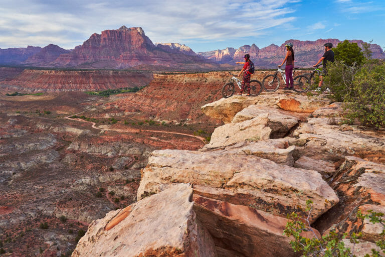 Group of mountain bikers on a ridge overlooking Gooseberry Mesa