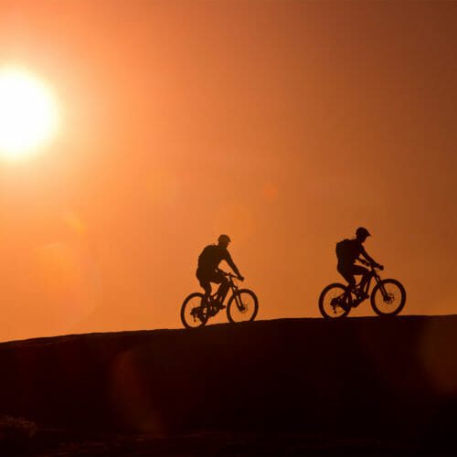Silhouette of mountain biking couple
