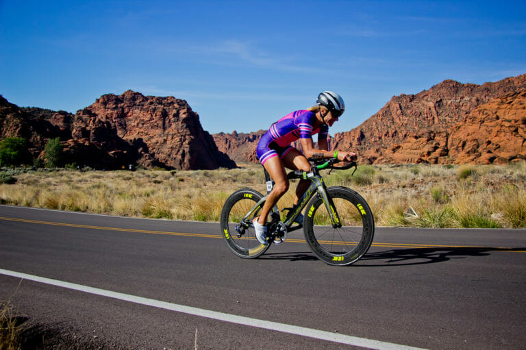 Woman cycling, training in the desert