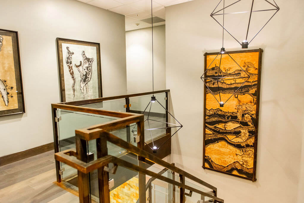Modern art hanging on wall and staircase