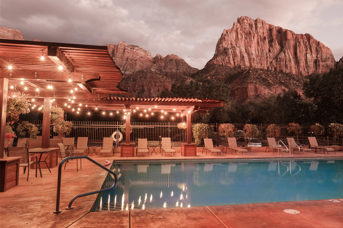 Outdoor pool at mountain hotel at dusk