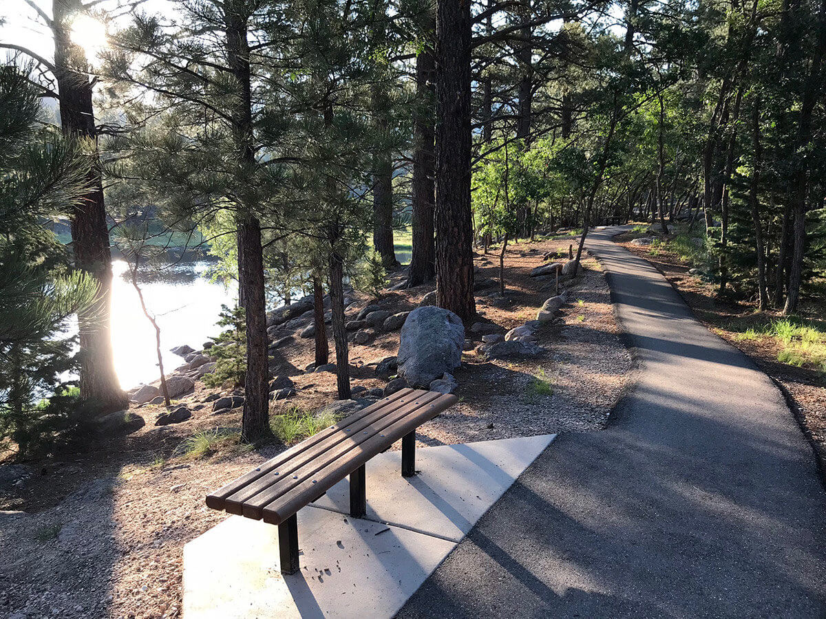 Bench on lakeside mountain path