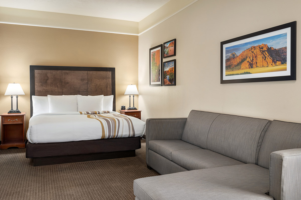 Hotel suite with bed and sofa