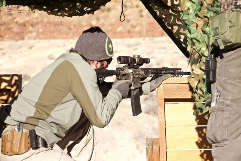 Man firing a tactical rifle