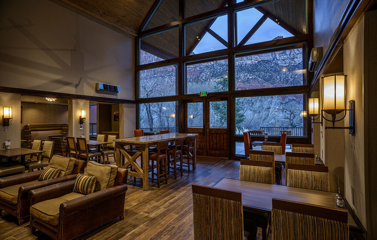 Lobby in mountain lodge with seating area and large windows