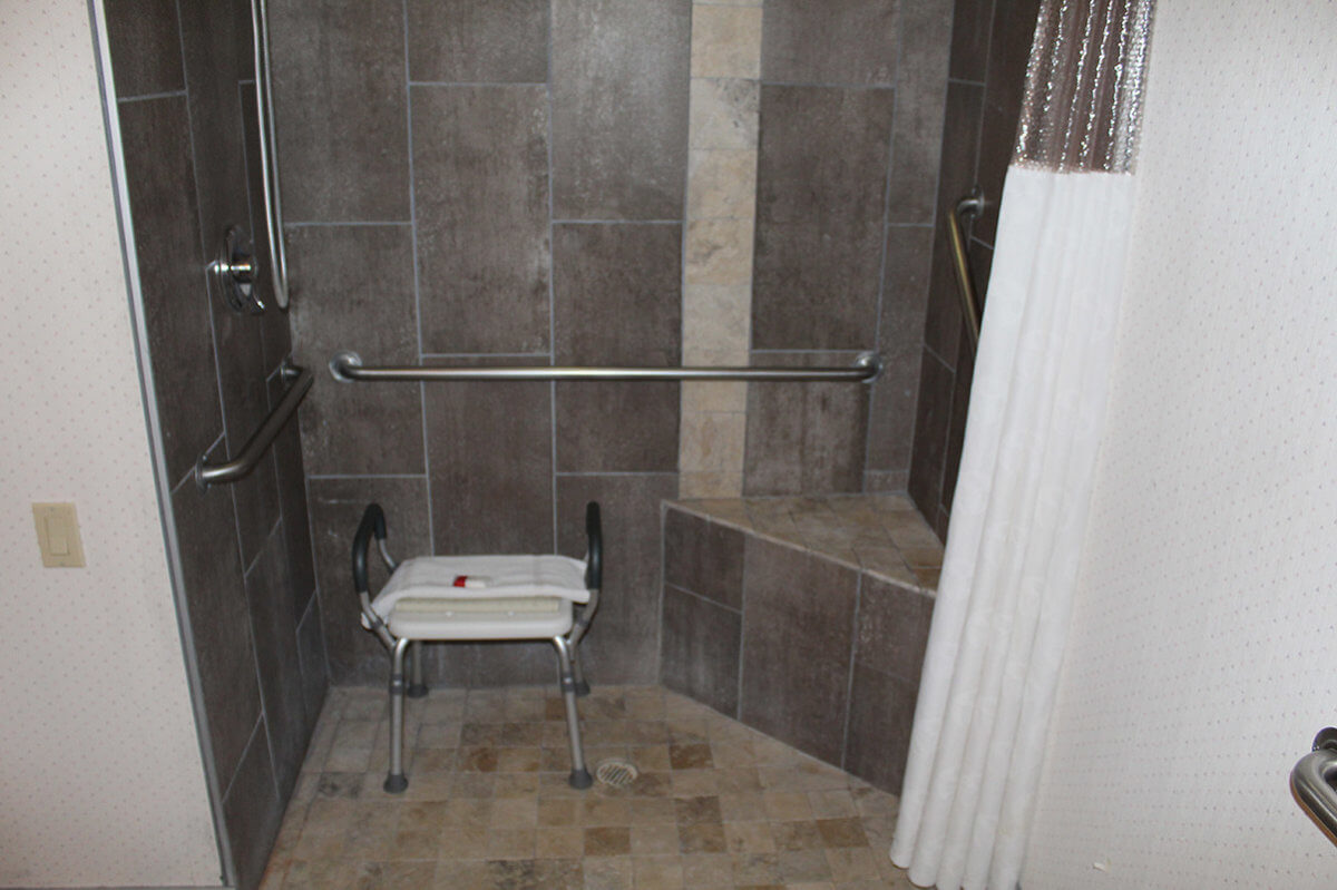 Hotel bathroom with tiled shower