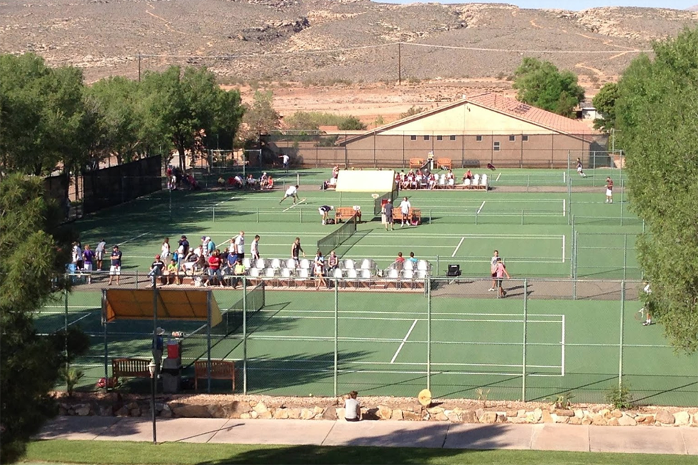 Aerial view of tennis court with players and spectators