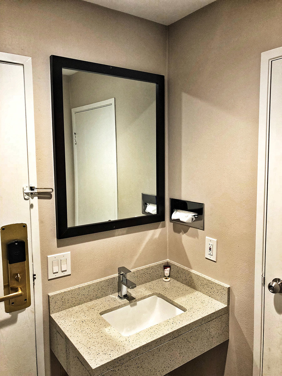 Hotel bathroom sink with mirror
