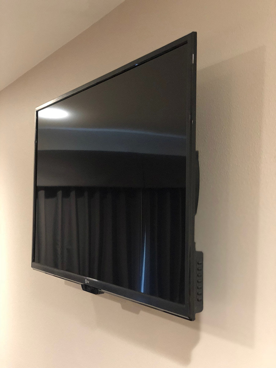 LCD TV hanging on wall