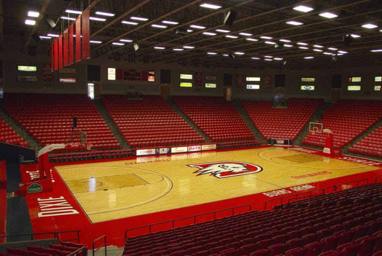 Wide view of basketball court in arena