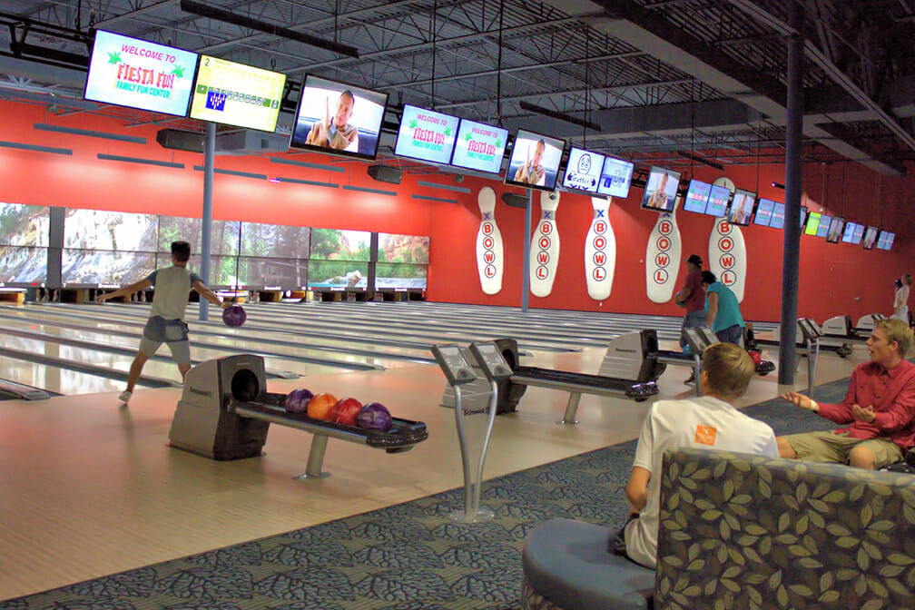 Young people bowling