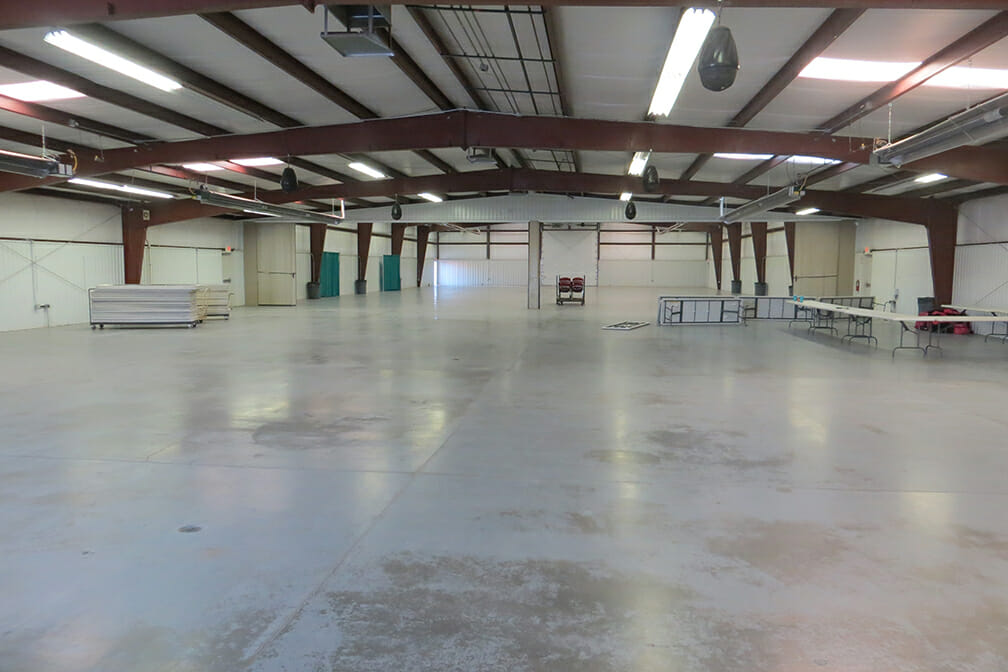 Large empty building with concrete floors