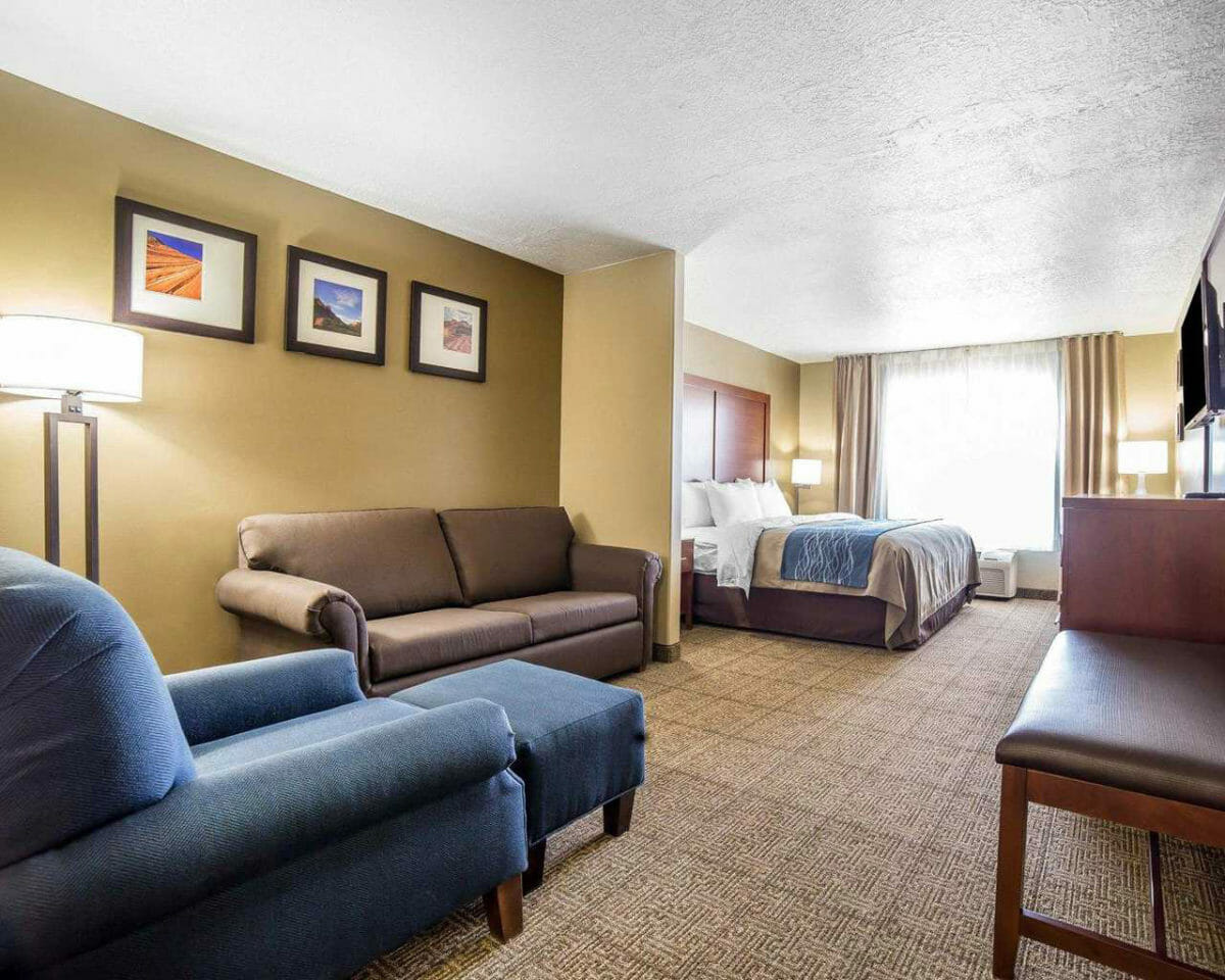 Hotel suite with king bed and seating area