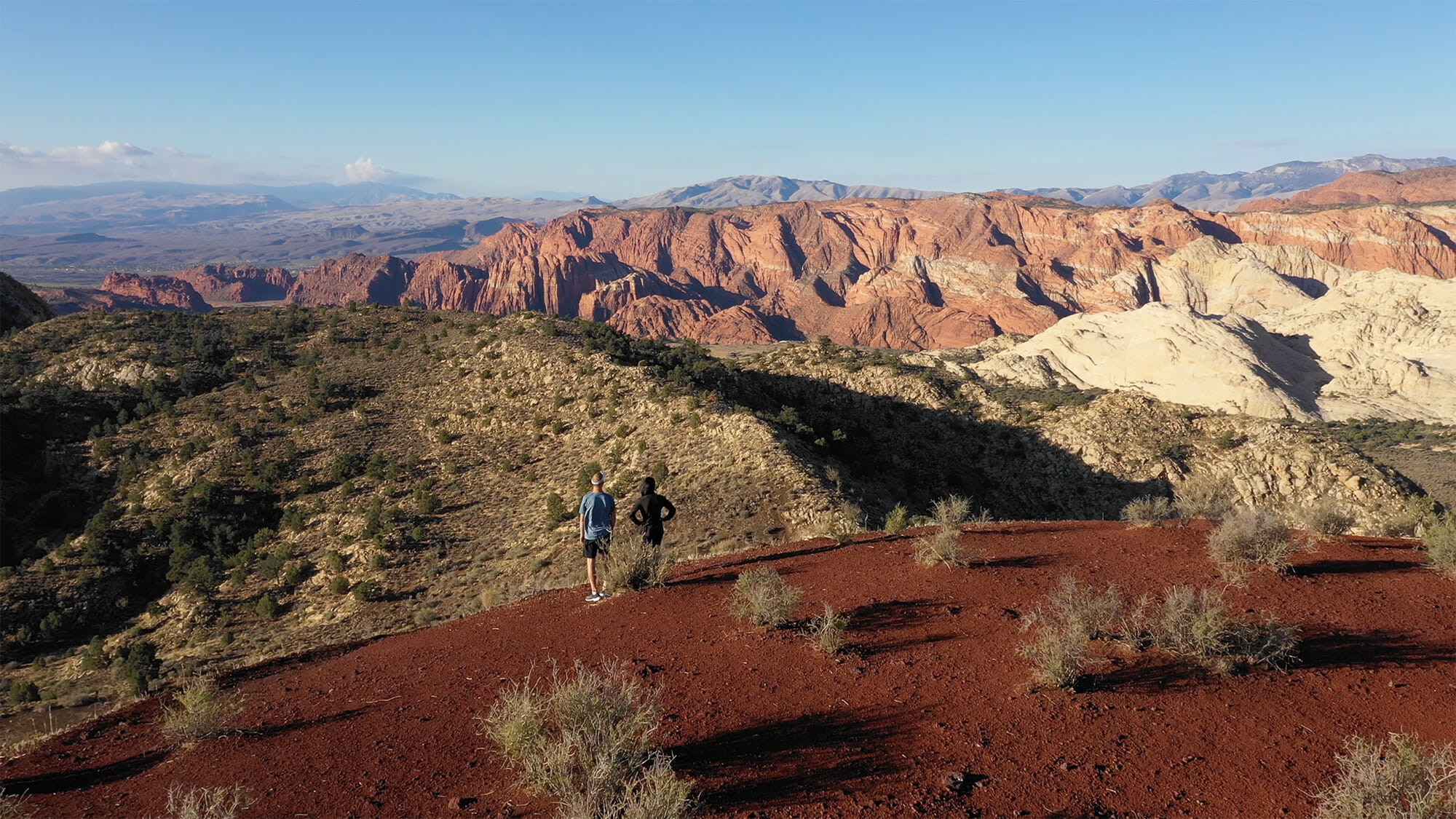 Couple standing atop the Cinder Cone with view of Snow Canyon State Park