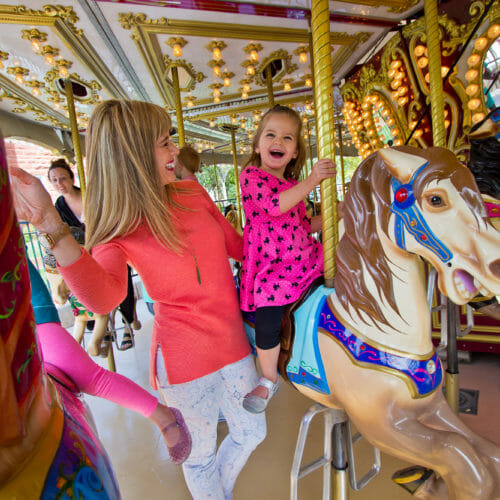 Mother and daughter riding Town Square Park carousel in downtown St. George, Utah