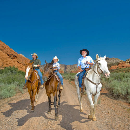 Men horseback riding in Snow Canyon State Park