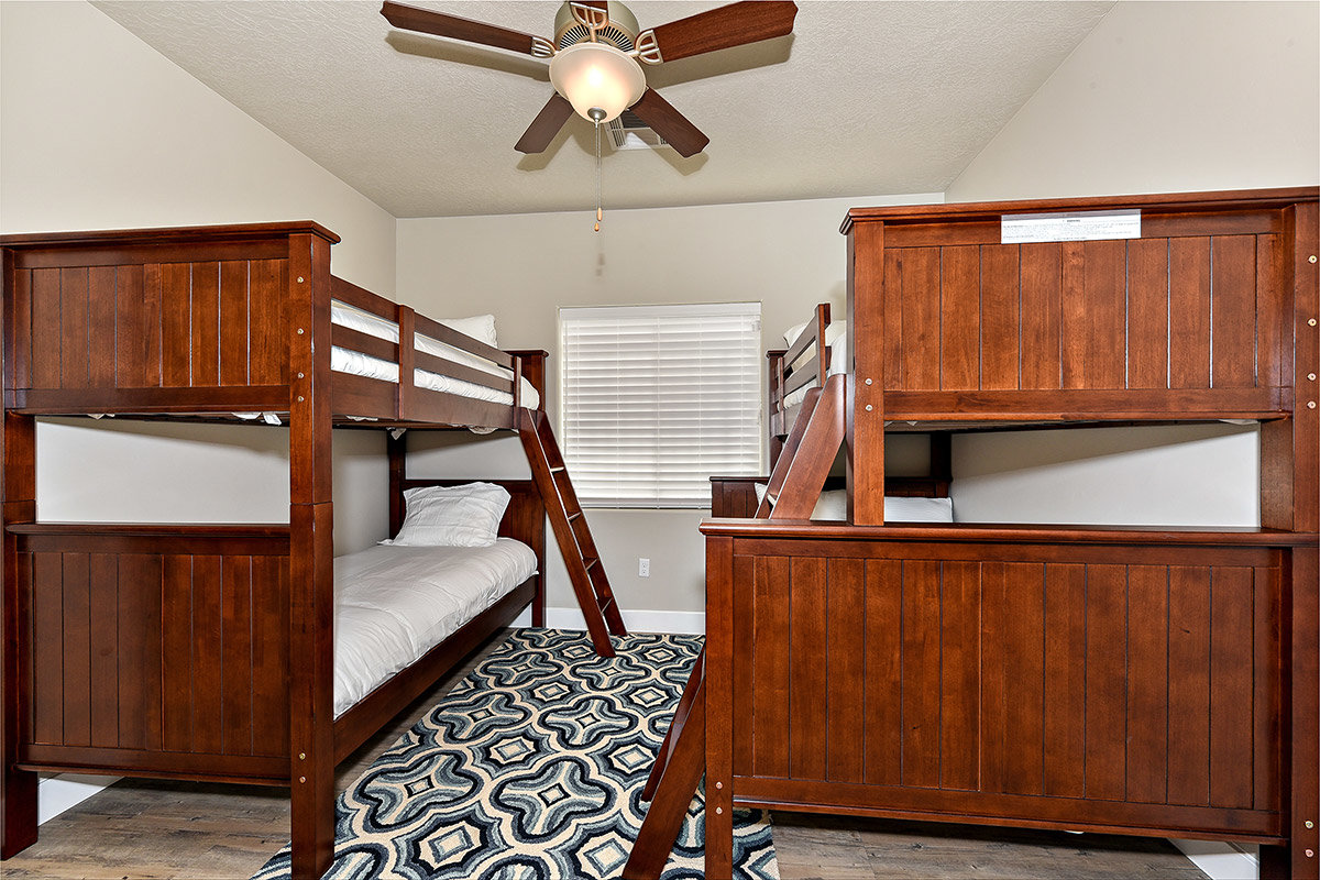 Hotel room with twin wooden bunk beds