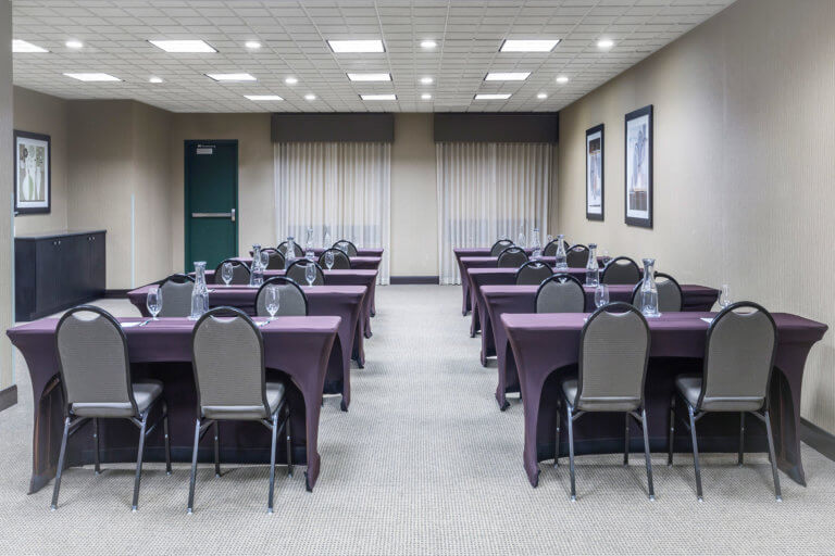 Hotel meeting room with purple table covers