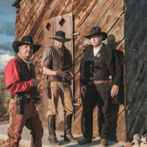 Three men dressed in old western outfits