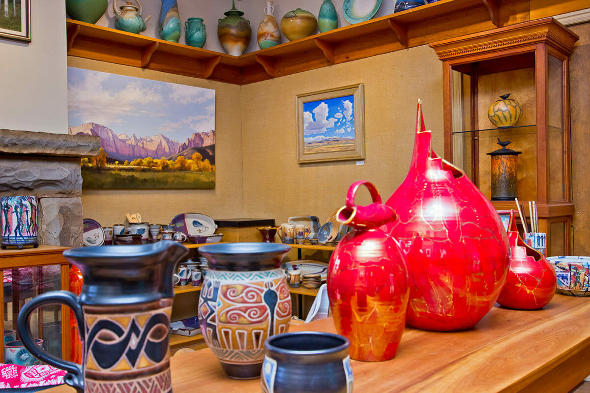 Brightly-colored pottery on display in an art gallery.