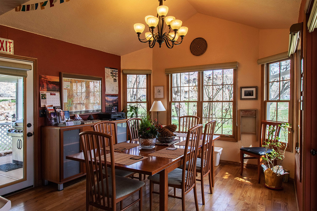 Dining room with wooden table and bay windows